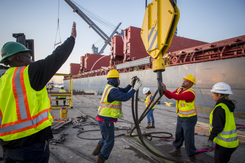 People working together at the Port of Houston along the Houston Ship Channel (Photo: Business Wire)
