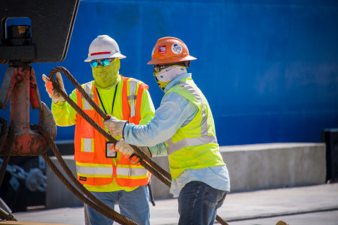 People working along the Houston Ship Channel (Photo: Business Wire)