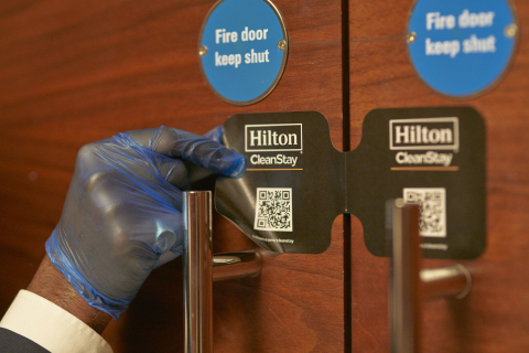 Team member places Hilton CleanStay Room Seal after full cleaning of ballroom at Conrad London St. James. (Photo: Business Wire)