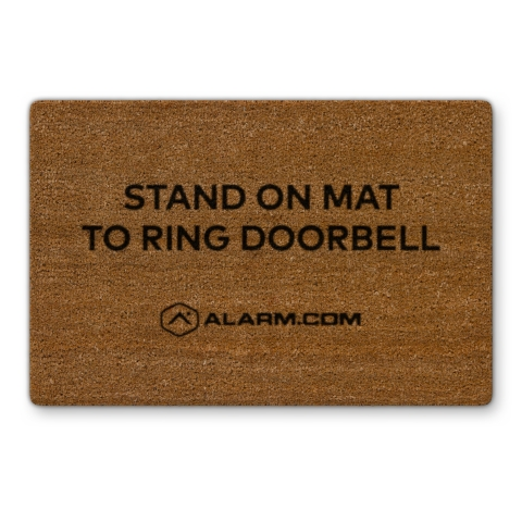 An accessory mat lets visitors know where to stand to automatically ring the Alarm.com Touchless Video Doorbell. (Photo: Business Wire)