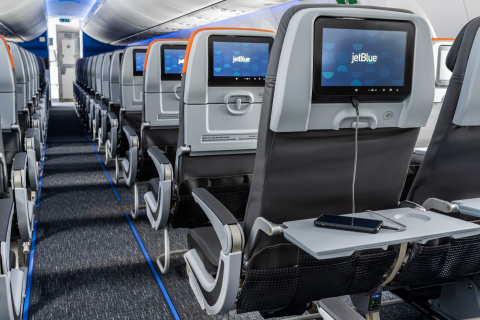 JetBlue's A220 aircraft features easy-to-reach in-seat power, featuring AC, USB-A, and USB-C ports at every seat. (Photo: Business Wire)