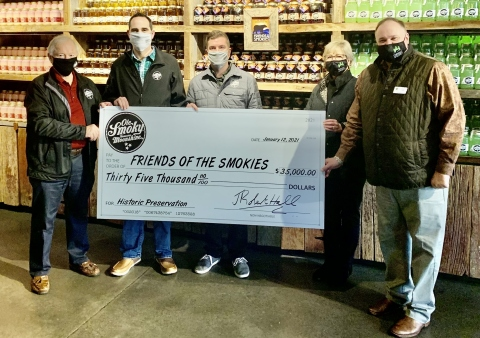 Ole Smoky Distillery has donated $35,000 to Friends of the Smokies. Pictured, left to right, Robert Hall , Ole Smoky Distillery, CEO, Cory Cottongim, Ole Smoky Distillery, President of Consumer Experience and Operations, Michael Simonis, Ole Smoky Distillery, Marketing Director, Lauren Gass, Friends of the Smokies, Senior Special Projects Director and Tim Chandler, Friends of the Smokies, Executive Director & CEO. (Photo: Business Wire)