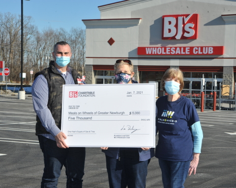 Craig Lombardi, general manager of BJ's Wholesale Club in Newburgh, N.Y. (left) presents a donation from the BJ's Charitable Foundation for a one-year supply of gas and tires to Robin Bello, executive director of Meals on Wheels of Greater Newburgh (center), and Carole McDermott, president of Meals on Wheels of Greater Newburgh (right) to celebrate the opening of the new BJ's Gas location in Newburgh. (Photo: Business Wire)