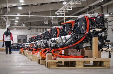 Assembled electric powertrains ready for installation into Lightning Electric Transit 350HD vehicles. (Photo: Business Wire)