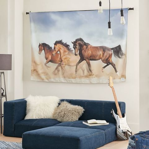 The Wrangler® x Pottery Barn Teen Collection includes sheet sets, patterned duvets, a denim quilt, pillowcases, a denim rug, horse mural tapestries, a denim hamper, a denim catchall, a denim bean bag and a denim sectional. (Photo: Business Wire)