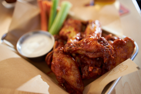 If the Big Game goes to OT, Buffalo Wild Wings is once again offering free wings for everyone in America. (Photo: Business Wire)