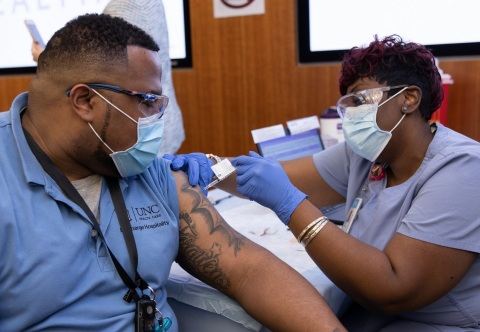 UNC Health administered its 100,000th COVID-19 vaccination today (February 2, 2021) since it began on December 15, 2020. In this photo, a UNC Medical Center employee receives his vaccination at the co-worker clinic in Chapel Hill. (Photo: Business Wire)