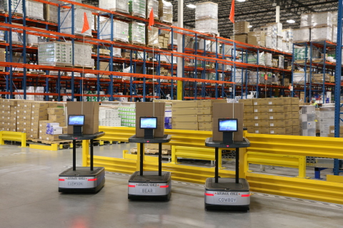 Distribution Management uses robots, which rely on secure wireless connectivity powered by Aruba, to assist with inventory management. Photo: Distribution Management