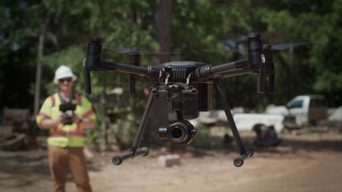 A PrecisionHawk drone pilot prepares to begin a site inspection. (Photo: Business Wire)