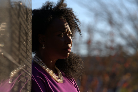 DeNeen Brown stands next to the Black Wall Street Memorial in Tulsa, OK. (Christopher Creese/National Geographic)