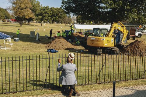 The Rev. Robert Turner of Vernon A.M.E. Church prays at Oaklawn Cemetery after learning that scientists found a mass grave during an excavation in the search for victims from the 1921 Tulsa Race Massacre. (Bethany Mollenkof/National Geographic)
