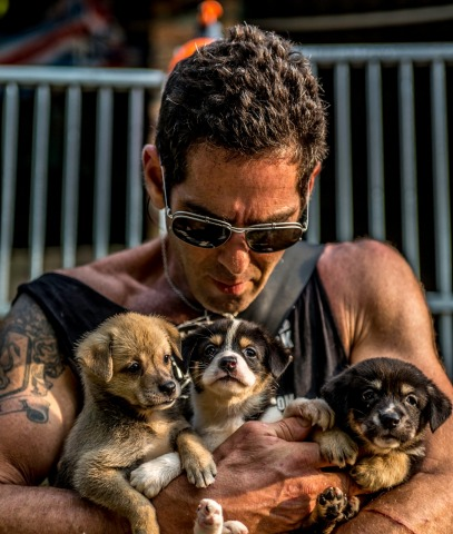 Jeffrey Beri, founder of No Dogs Left Behind, rescuing puppies from a slaughterhouse in China (Photo: Business Wire)