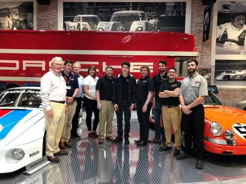 Pictured from left: Dano Davis, and his team at the Brumos Collection with Brian Martin, director of Automotive Restoration Projects at McPherson College; and students Daniel Journey, Tim Lauring, Kevin Boeckman, Gerardo Menez, Jr.; and Aaron Israel, 2018 graduate of McPherson College and assistant manager at the Brumos Collection. (Photo: McPherson College)