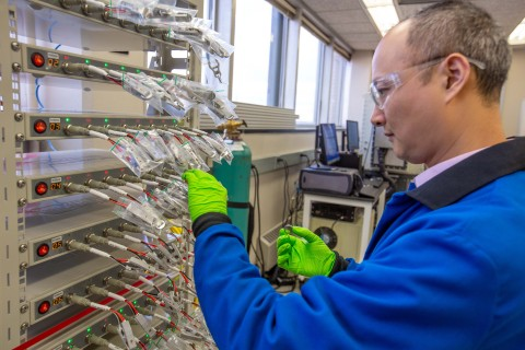 Phillips 66 Senior Engineer Liang Zhang is shown testing small batteries to evaluate Phillips 66 carbon products as sodium-ion battery anode materials. (Photo: Phillips 66)
