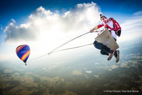 Austrian photographer Philip Platzer gets the perfect in-air shot of Red Bull Skydive teammate, Marco Fürst, participating in The Megaswing Project. (Photo: Philip Platzer/ Red Bull Illume)