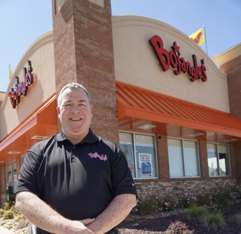 Jeff Rigsby celebrates his 20th year as a Bojangles' franchisee by signing a substantial expansion agreement with the Southern chain. (Photo: Bojangles)