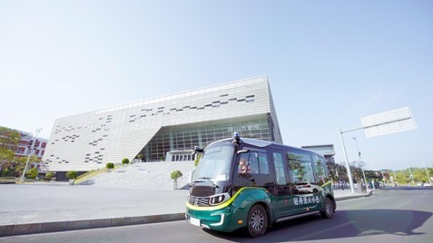 An Ouster lidar sensor on a QCraft robobus (Photo: Business Wire)
