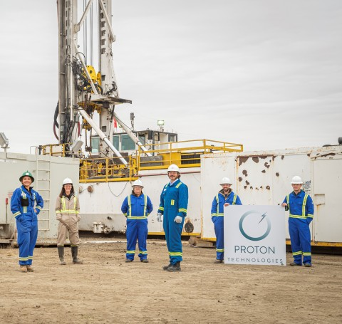 Proton Technologies Canada team members pose in front of the world's first hydrogen well. (Photo: Business Wire)
