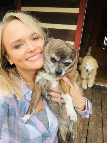 Photo Courtesy of Miranda Lambert Pictured with two of her shelter dogs, Delta and Jessi.