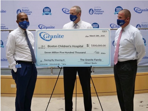 Kevin Churchwell, President and COO of Boston Children's Hospital with Massachusetts Governor Charlie Baker receives a donation check for $7.5 million from Granite CEO Rob Hale, culminating Granite's Saving by Shaving 8th annual fundraiser.  (Photo: Business Wire)