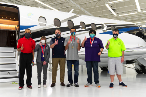 Textron Aviation President & CEO Ron Draper (pictured third from left) with Special Olympics Kansas athletes. (Photo: Business Wire)