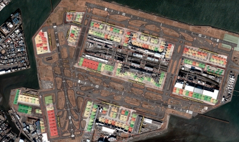 Using high-revisit satellite imagery, BlackSky's Spectra AI has detected the utilization of major facilities at Tokyo's Haneda Airport. Parking spaces shown in green are rarely used, while red indicates frequent occupancy. BlackSky customers can also understand inflow/outflow of cargo and monitor airline maintenance activity. (Photo: Business Wire)