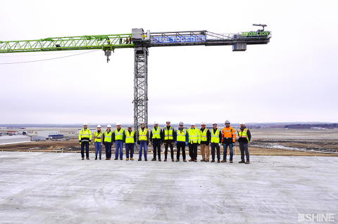 SHINE executives are joined by the company's construction managers and partners at its medical isotope production facility. The group was commemorating the facility's achievement of weathertight status. (Photo: SHINE Medical Technologies)