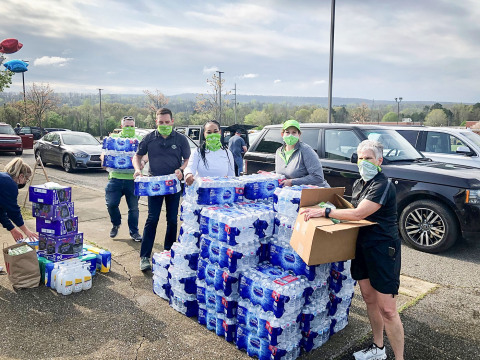 Teams from Regions Bank gathered at Oak Mountain High School near Birmingham, Ala., to deliver food, water and cleaning supplies for people impacted by the tornado outbreak. (Photo: Business Wire)