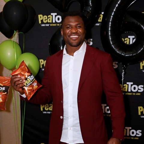 Francis Ngannou celebrates his win with PeaTos. (Photo: Business Wire)