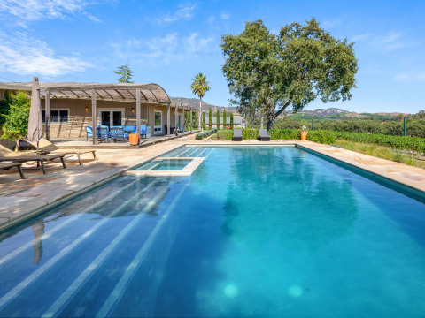 The deal brings Vacasa's full-service vacation rental management to new destinations, including Napa, California. (Photo: Vineyard Estate w/Hot Tub & Pool)
