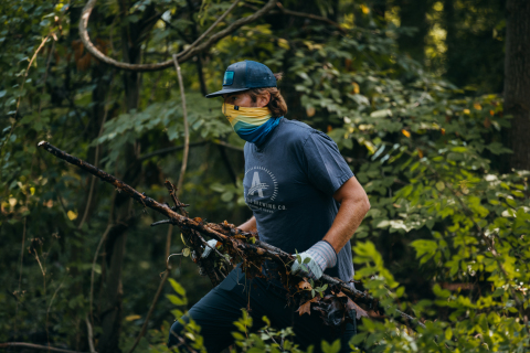 Athletic Brewing Company volunteer at a trail clean-up for the Two For The Trails program. (Photo: Business Wire)