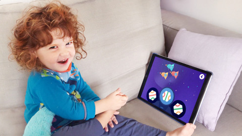 The child is having fun playing Funexpected Math on the iPad. (Photo: Business Wire)