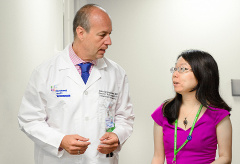 Alex C. Spyropoulos, MD, professor at the Feinstein Institutes speaks with a colleague. (Credit: The Feinstein Institutes for Medical Research)