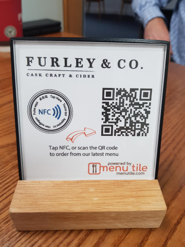 qiiosk Ltd. uses HID Global NFC Tags to meet skyrocketing demand from restaurants and diners for its product Menu Tile, to give a completely contact-free dining experience. (Photo: Business Wire)