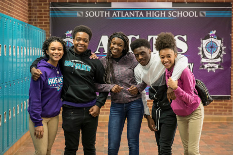 South Atlanta High School students smile and gather, showcasing their school's spirit. South Atlanta High School will begin implementing the comprehensive, evidence-based prevention model BARR (Building Assets, Reducing Risks) with ninth-grade students. NOTE: This photo was captured pre-COVID during the 2018-2019 academic year. Students and staff are required to were masks in all APS buildings. (Photo: Business Wire)