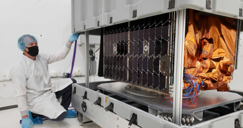 Astranis employee Will Harden with an Astranis satellite. (Photo: Business Wire)