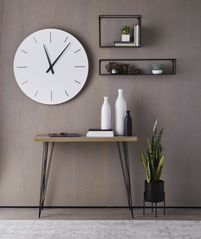 The Loom + Forge™ collection features refined modern indoor decor. Clean lines, bold contrast, and sophisticated style are seen throughout. It includes wall decor, planters, and vases.