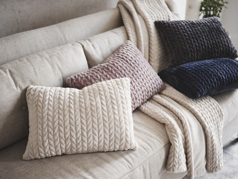 The Loom + Forge™ collection includes coordinating plush throws and pillows in several easy-to-blend colors. (Photo: Business Wire