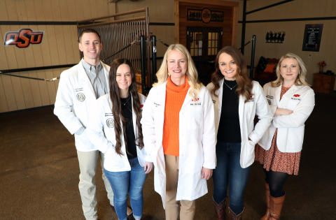 OSU Medicine students with a focus on rural health stand around OSU-CHS President Dr. Kayse Shrum. (Photo: Business Wire)