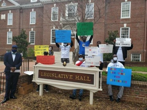 Activists protest the lack of diversity on the Chancery Court (Photo: Business Wire)