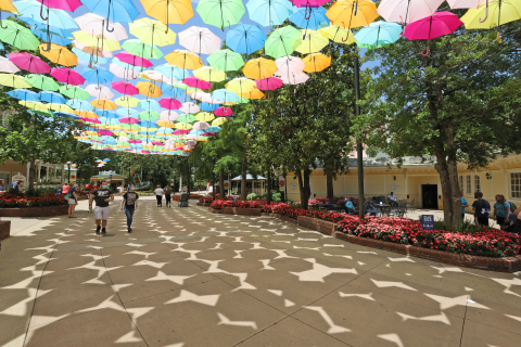 """Dollywood guests are greeted by an """"Umbrella Sky"""" as they enter the park during the Flower & Food Festival presented by Covenant Health. This colorful installation has become a favorite photo spot for visitors. (Photo: Business Wire)"""