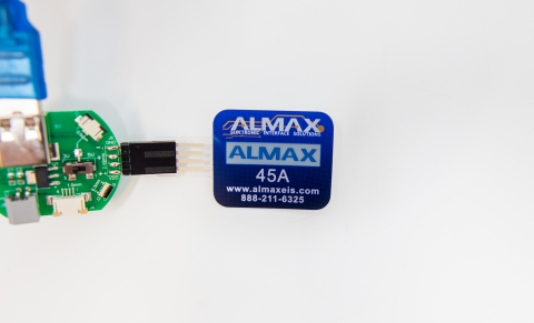 ALMAX has produced 200 production-ready demonstrators integrating Ynvisible electrochromic displays into ALMAX electronics, customized with the ALMAX logo and contact information. (Photo: Business Wire)