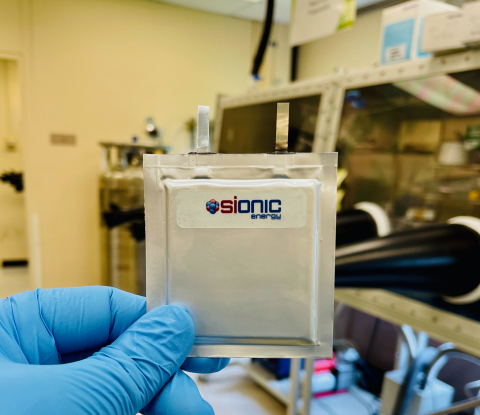 A member of the Sionic Energy team holds one of the company's silicon battery cells, which deliver up to 50% greater energy density, 30% lower cost, and increased safety, and can be integrated into cylindrical, pouch, or prismatic cell formats in existing cell production supply chains and infrastructure. (Photo: Business Wire)