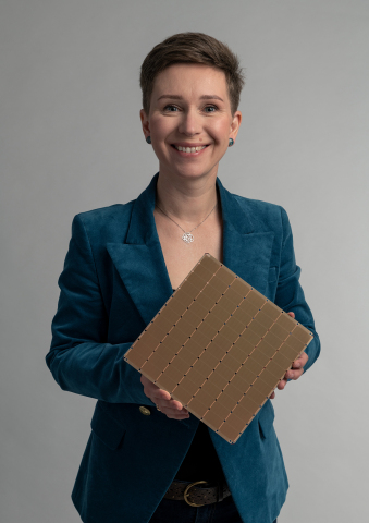 Natalia Vassilieva, Senior Technical Product Manager, Machine Learning at Cerebras Systems, holds the WSE-2. (Photo: Business Wire)