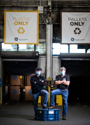 GEA employees pose for a photo in front of the Plastic Only and Pallets Only bay at Appliance Park in Louisville. (Photo: GE Appliances, a Haier company)