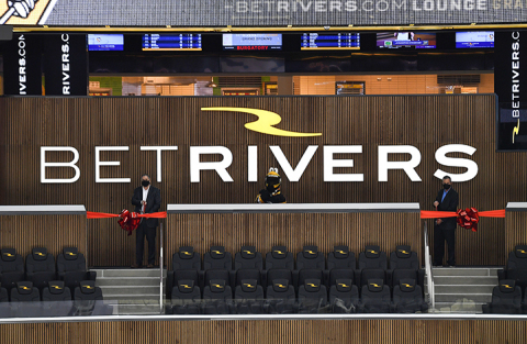 President and CEO of the Pittsburgh Penguins David Morehouse (left), Iceburgh, and General Manager of Rivers Casino Pittsburgh Bill Keena (right), cut the ribbon for BetRivers Lounge at PPG Paints Arena. Photo Credit: Joe Sargent.