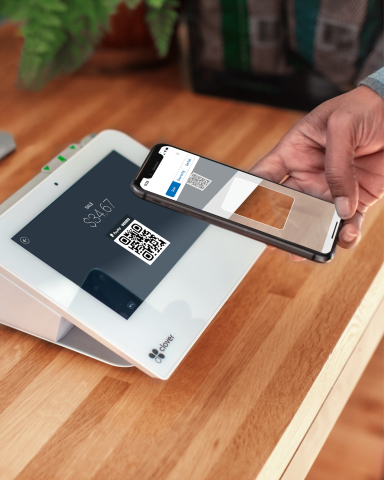 PayPal QR Code being scanned from a Clover POS device (Photo: Business Wire)