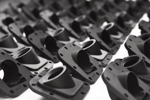 Stratasys Origin One 3D打印机专为批量生产应用而设计,例如这些摄像头外壳。(照片:美国商业资讯)
