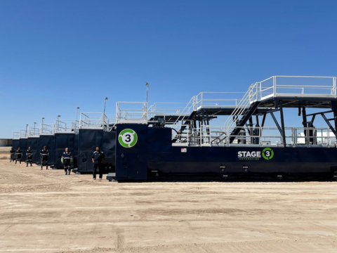 Stage 3 Separation field technicians next to equipment. (Photo: Business Wire)