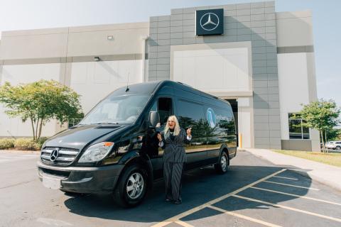 Kim's Open Door founder, Kim Bogart, takes delivery of her organization's Mercedes-Benz Sprinter Passenger Van that was refurbished by Mercedes-Benz USA employees. (Photo: Business Wire)